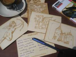 A selection of wooden postcards on a table