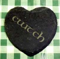 Heart shaped slate coaster engraved with the word 'Cwtch'